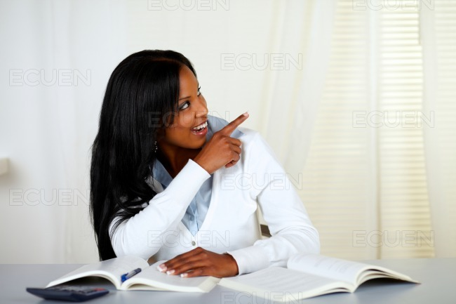 Afro-american student looking and pointing stock photo