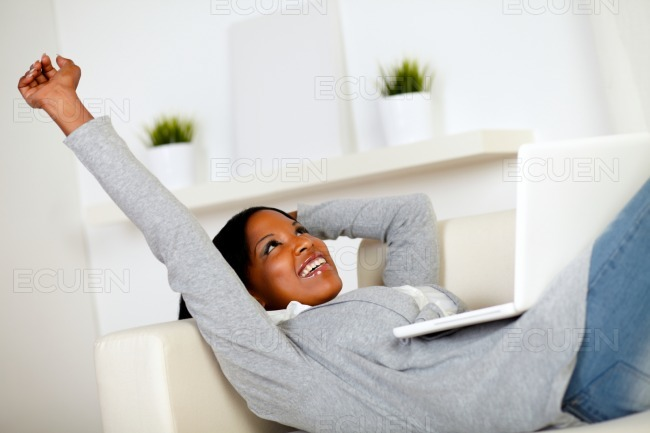Afro-american woman browsing the Internet stock photo