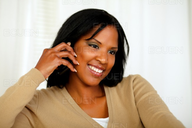 Afro-american woman conversing on mobile phone stock photo