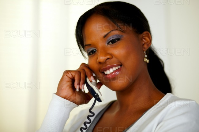 Afro-american woman conversing on phone stock photo