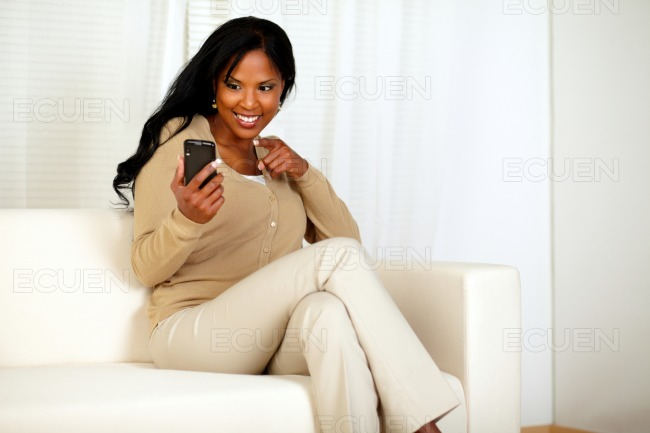 Afro-american woman pointing her cellphone stock photo