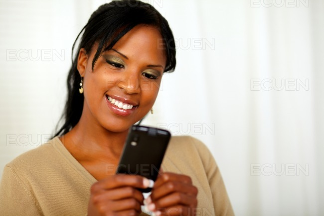 Afro-american woman sending a message stock photo