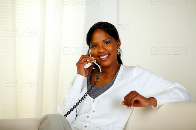 Afro-american woman smiling at you stock photo