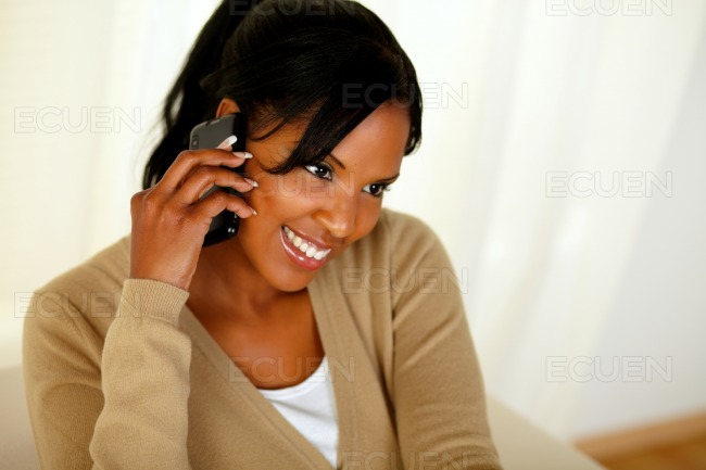 Afro-american woman speaking on mobile phone stock photo
