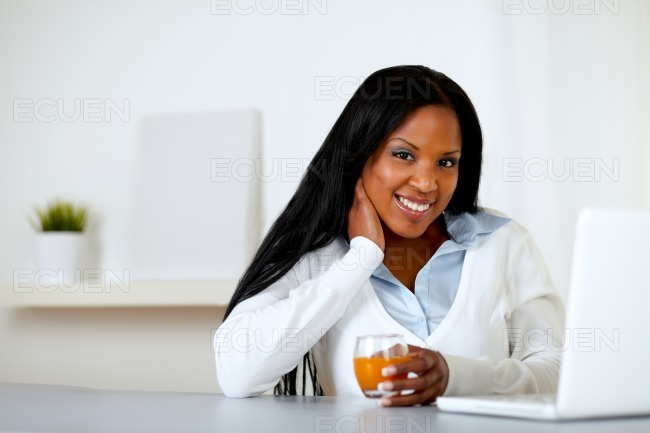 Afro-american woman with an orange juice stock photo