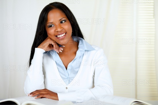 Afro-american young black girl studying stock photo