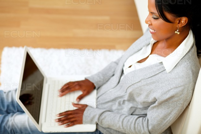 Afro-american young woman browsing the Internet stock photo