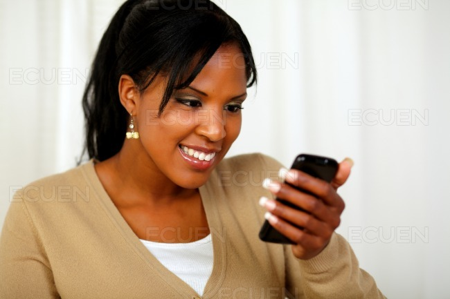 Afro-american young woman sending a message stock photo