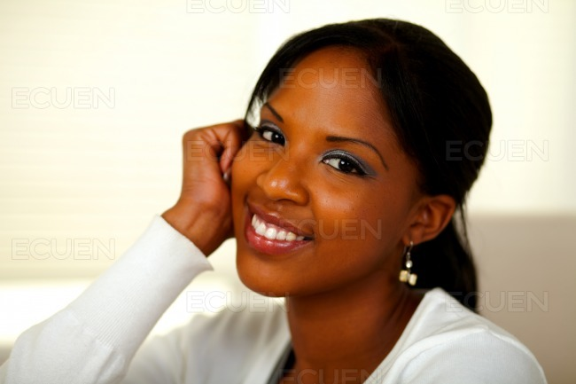 Afro-american young woman smiling at you stock photo
