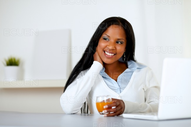 Afro-american young woman with an orange juice stock photo