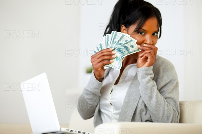 Ambitious excited black woman with money stock photo