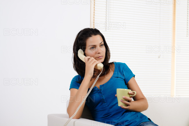 Angry woman talking on the phone. stock photo