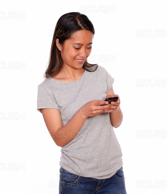 Asiatic young woman sending a message stock photo