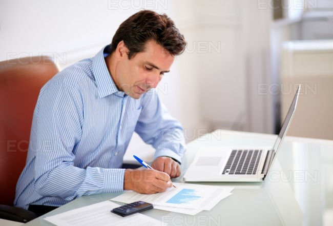 Attractive boss working on his documents stock photo