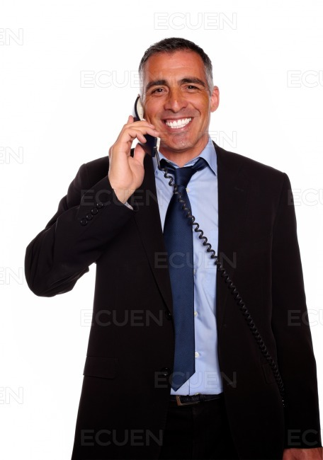 Attractive broker laughing on phone stock photo