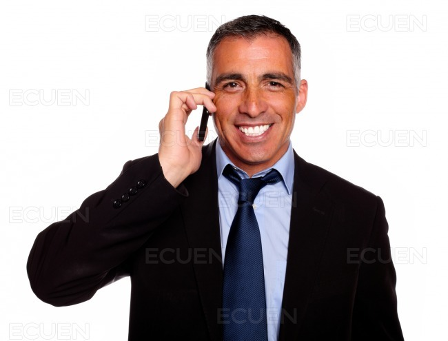 Attractive businessman speaking on mobile stock photo