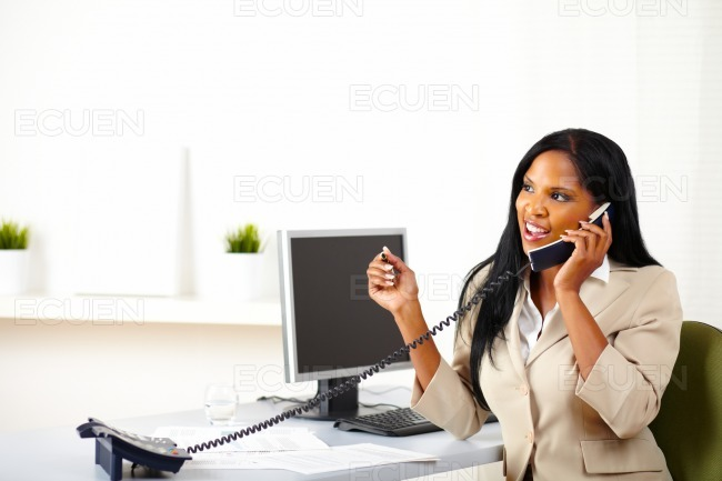 Attractive businesswoman on phone stock photo