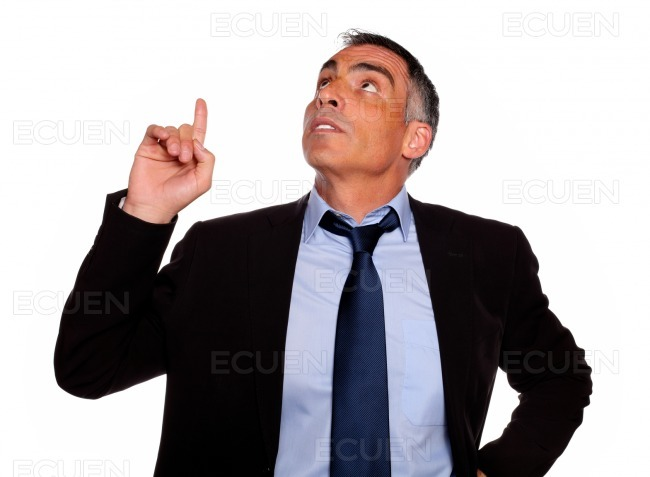 Attractive executive looking and pointing up stock photo