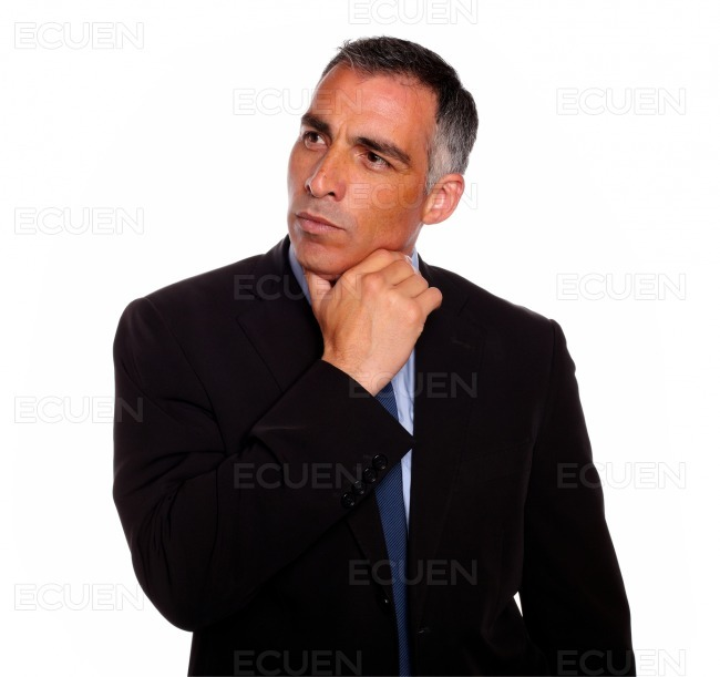 Attractive hispanic broker meditative stock photo