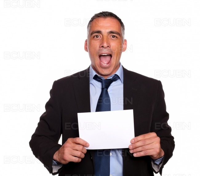 Attractive man holding a white card with copyspace stock photo