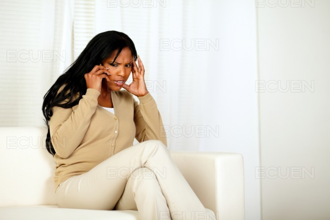 Attractive woman conversing on cellphone stock photo