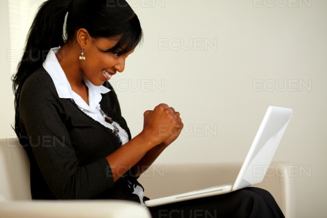 Attractive woman on black suit with a laptop stock photo
