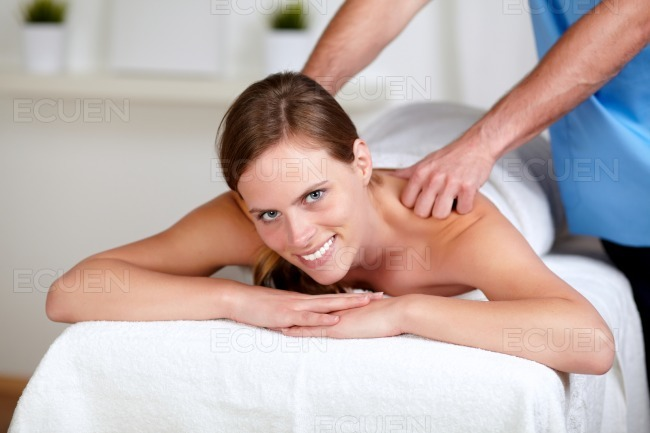 Attractive woman receiving a body massage at a spa stock photo
