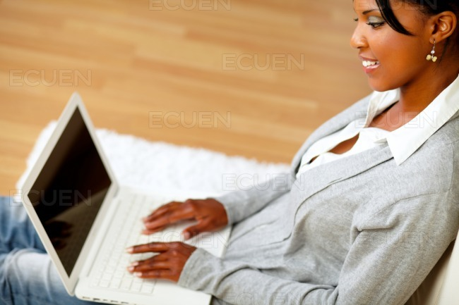 Attractive woman working on laptop stock photo