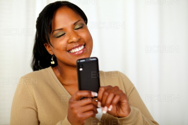 Attractive young woman reading a message on mobile stock photo