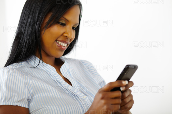 Attractive young woman reading on a mobile stock photo