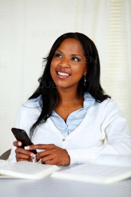 Attractive young woman using a cellphone stock photo