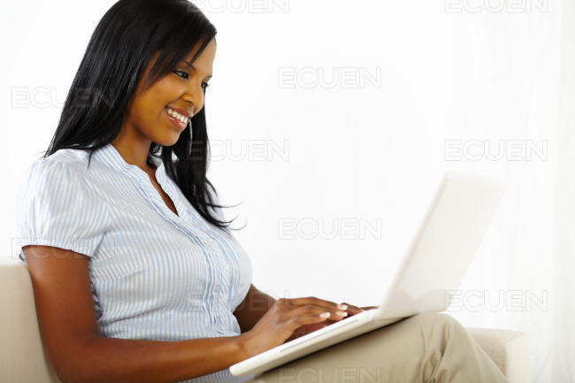 Attractive young woman using a laptop stock photo