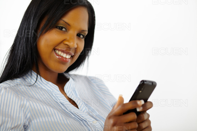 Attractive young woman using a mobile stock photo