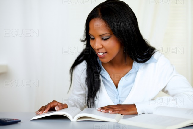 Beautiful black girl studying stock photo