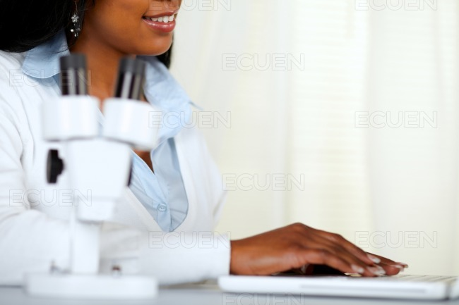 Beautiful black young woman working at laboratory stock photo