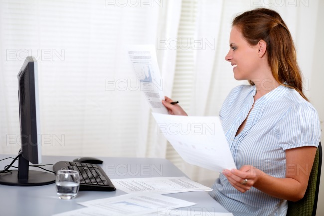 Beautiful blonde female holding documents stock photo