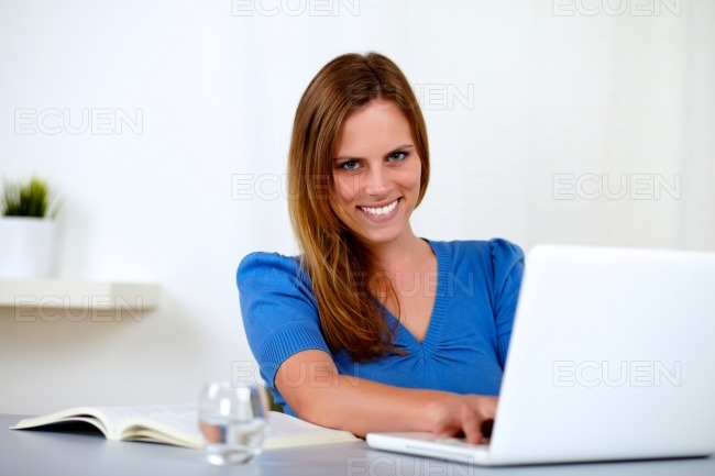 Beautiful blonde girl studying stock photo