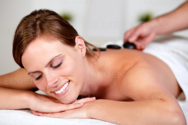 Beautiful blonde woman smiling at spa stock photo
