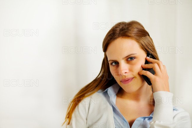 Beautiful businesswoman talking on the mobile phone stock photo