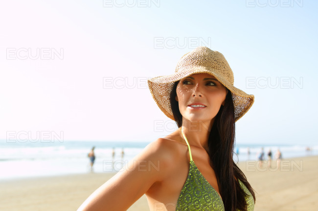 Beautiful woman on the beach stock photo
