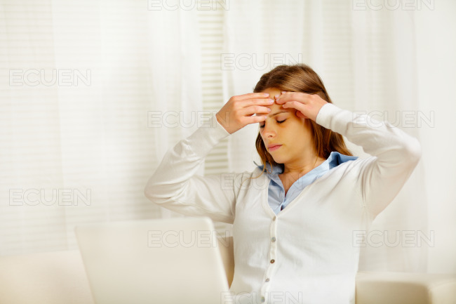 Beautiful woman with headache in from laptop stock photo