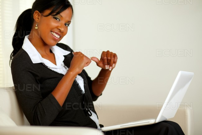 Beautiful young business woman working on laptop stock photo