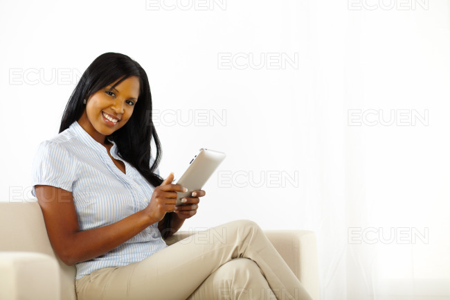 Beautiful young woman using a tablet PC stock photo