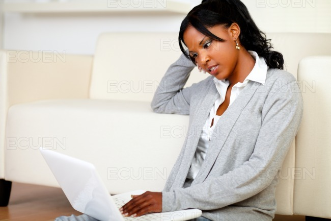 Beautiful young woman working relaxed on laptop stock photo
