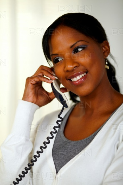 Black woman smiling and speaking on phone stock photo