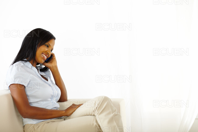 Black young woman on mobile stock photo