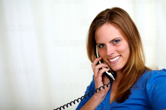 Blonde friendly young lady on phone stock photo