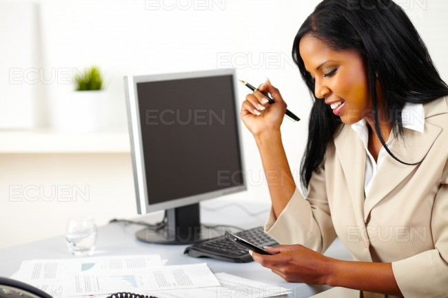 Business lady reading a message on cellphone stock photo