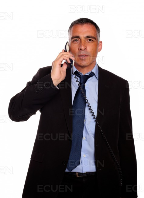 Business man conversing on phone stock photo
