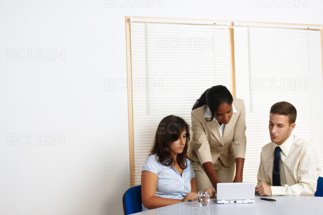 Business people working with a laptop stock photo